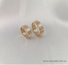 Обручальные кольца три камня