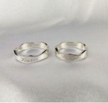 Обручальные кольца в виде волны