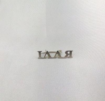 Значок с надписью