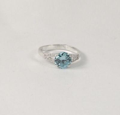 Кольцо с цирконами голубыми